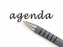 Agenda. Pen writing word 'agenda stock photo