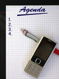 Agenda. Mobile phone with pen are on business notepad Stock Photo