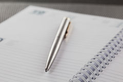 Agenda. Close-up on an open agenda. Blank page. Shallow depth of field stock photography