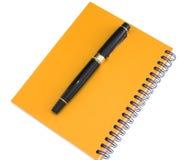 Agenda amarilla y pluma Fotos de archivo libres de regalías