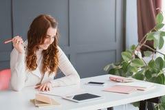 Agenda ambitious marketing plans content smm woman. Scheduling agenda. Ambitious marketing plans. Content smm woman at workplace. table, tablet and smartphone stock photos