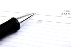 Agenda and ball pen Stock Photography