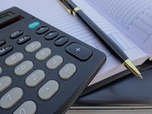 Office supplies: Planner with pen and calculator . Royalty Free Stock Photography