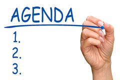 Agenda checklist. Hand of a female drawing a business agenda checklist on a white background with copy space Royalty Free Stock Photos