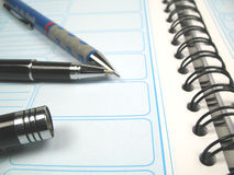 Agenda close-up. A pen and pencil lying on an agenda Royalty Free Stock Photo