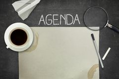 Agenda concept on black blackboard with empty Royalty Free Stock Photo