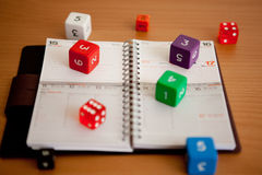 Agenda with dices. Agenda with dices in a brown table Royalty Free Stock Photography