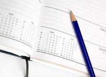 Agenda et crayon Photographie stock libre de droits
