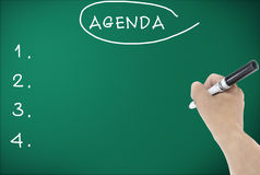 Agenda hand writing. On blackboard Stock Image