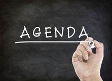 Agenda with hand writing. On blackboard Royalty Free Stock Images