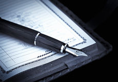 Agenda and ink pen Stock Images