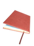 Agenda. On isolate brown diary Stock Images