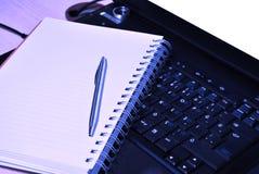 Agenda and laptop Stock Image