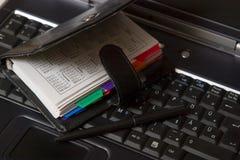 Agenda on laptop keyboard Royalty Free Stock Image