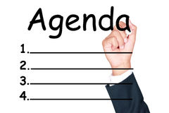 Agenda list. Write by businessman on white background royalty free stock photo