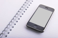 Agenda and mobile phone Stock Image