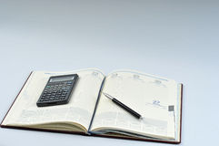 Agenda, pen and calculator Stock Image