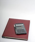 Agenda, pen and calculator. Image of year planner with pen and calcularor - budget time royalty free stock photos