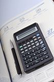 Agenda, pen en calculator stock afbeelding
