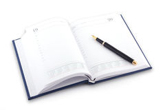 Agenda and pen on white background Royalty Free Stock Image
