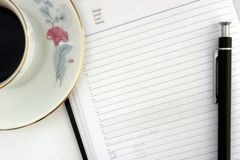 Agenda Pending. Coffee, pen and agenda at the begining of a days work royalty free stock photos
