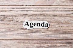 AGENDA słowo na papierze Pojęcie Słowa agenda na drewnianym tle Fotografia Royalty Free