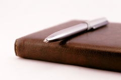 Agenda and silver pen Royalty Free Stock Images