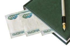 Agenda, vulpen en Russische roebels op een lichte achtergrond Royalty-vrije Stock Foto