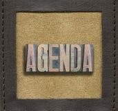 AGENDA word framed. AGENDA word assembled from vintage wooden letterpress inside stitched leather frame Royalty Free Stock Photo