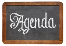 Agenda word on blackboard Stock Images