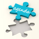 Agenda word on blue puzzle Royalty Free Stock Photography