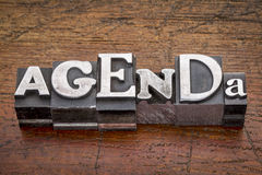 Agenda word in metal type. Agenda  word in mixed vintage metal type printing blocks over grunge wood Stock Image
