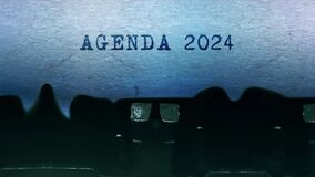 Agenda 2024 words Typing on a sheet of paper with an old vintage typewriter.