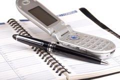 Agenda y teléfono celular Fotografía de archivo