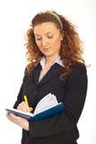 agendy biznesowy rudzielec kobiety writing Zdjęcie Royalty Free