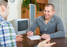 Agent and client with documents at home Royalty Free Stock Photo