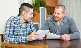 Agent and client with documents at home Royalty Free Stock Photography