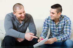 Agent and client with documents at home Stock Photography
