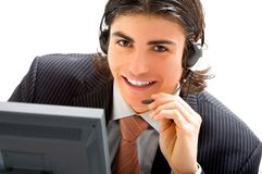Agent communication. Young hot liner answer and smiling Stock Photography