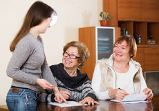 Agent consulting elderly women Stock Image