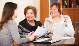 Agent consulting elderly women Stock Images