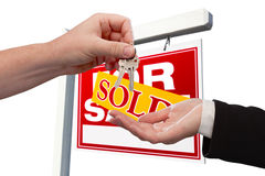 Agent Handing Over the Key to a New Home Stock Photo