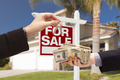 Agent Handing Over Keys, Buyer Handing Over Cash for House Royalty Free Stock Images