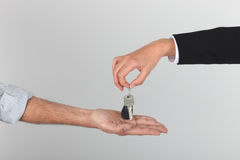 Agent handing over keys. To a new home Stock Photography