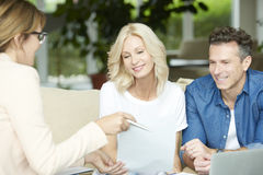 Agent and her clients consulting Stock Photography