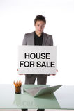Agent holding a House For Sale sign Stock Photos