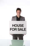 Agent holding a House For Sale sign Stock Images