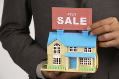 Agent holding a sign Royalty Free Stock Photo