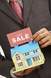 Agent holding a sign Royalty Free Stock Images