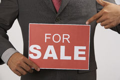 Agent holding a sign Royalty Free Stock Image